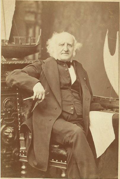 Pâris à sa table de travail au musée de Marine, vers 1885. Coll. J. Coutant.Barron
